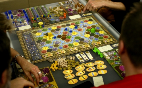 Terra Mystica in play at Essen 2012. Picture by Daniel Danzer (duchamp) from BGG.